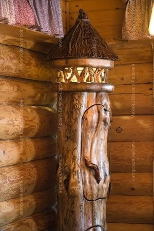 Bar from a log with a lamp
