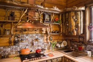 The facade of the kitchen is from a croaker, decorated with a wood-carver